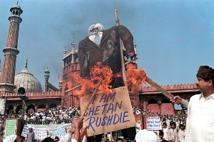 Indian Moslems burn an effigy of British