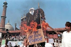 Indian Moslems burn an effigy of British