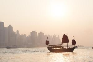 chinese-junk-boat-sailing-in-hong-kong-harbor-matteo-colombo