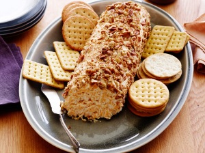 RANCH DRESSING CHEESE LOG Trisha Yearwood Trisha's Southern Kitchen/Trisha Yearwood Food Network Cream Cheese, Mayonnaise, Buttermilk, Ranch Dressing Mix, Cheddar Cheese, Pecans, Crackers or Bagel Chips
